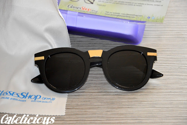 Black and gold round sunglasses